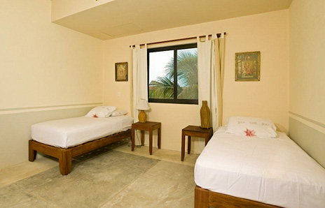 Twin beds can be made up as a king at Hacienda de Mar vacation villa in Puerto Aventuras