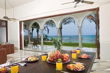 Dining area overlooks the pool and ocean at the hacienda del mar luxury villa in Puerto Aventuras