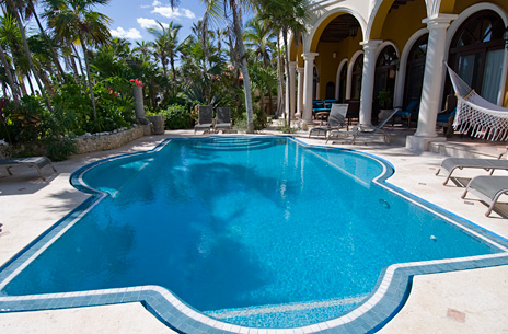Swimming pool is gorgeous at this Riviera Maya luxury vacation villa on Soliman Bay