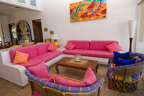 Colorful living room at Twin Palms Akumal vacation rental property