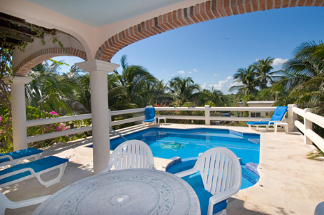 Poolside patio at Twin Palms vacation rental villa in Akumal