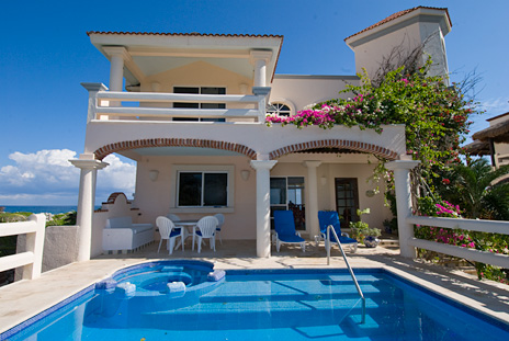 Front Twin Palms and the swimming pool and patio at this Akumal vacation rental villa