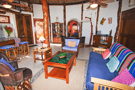 Futon in the living room  at Nah Yaxche vacation rental home on Soliman Bay